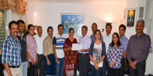 Handed over a cheque to Padmasree Sr. Sudha Varghese